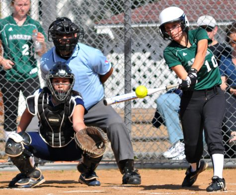 Team Captain, Christine Zaccaro, slams one into the outfield and leads her team to victory.