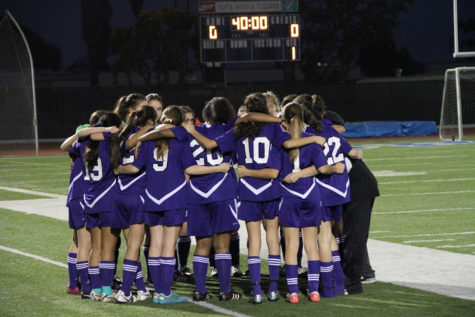 The Archer Varsity huddles in anticipation for the forthcoming game.  Bryan Cranston/Picasa Web Album