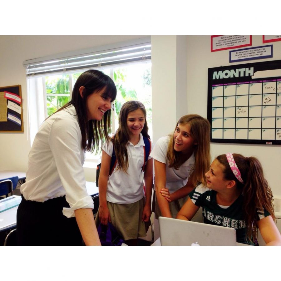Ms. Lucy Pinkwater works with a group of eighth graders in class.