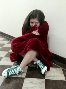 A student wraps herself in a thick warm blanket. Photographer: Sara Seaman '16