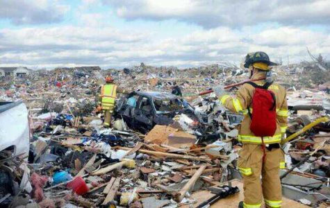 Firefighters in Washington, Illinois, look across the destruction the tornado caused. Source: Fox2Now