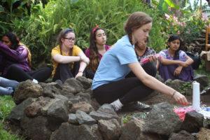 The Archer girls help set up for the Mayan ceremony. Photographer: Travis Nesbitt