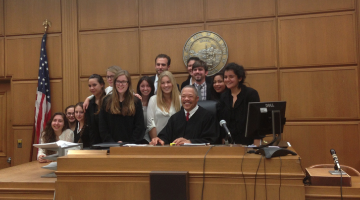 Mock+Trial+competition+on+November+4th+pose+with+the+judge.+