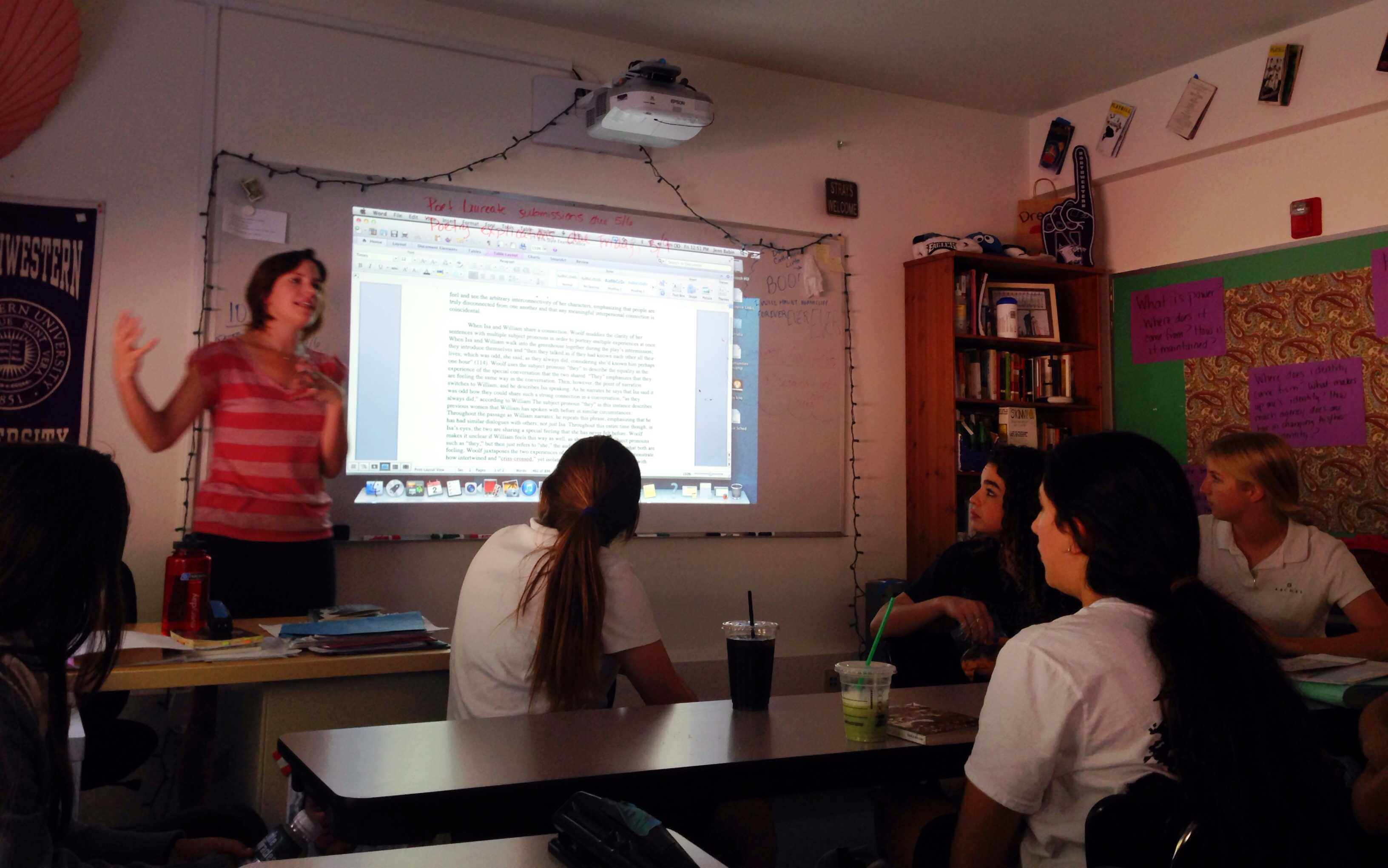 Ms. Babin teaching her English 10 Honors course.  They are now learning about Virginia Woolf; specifically Between the Acts. Photographer: Syd Stone '16