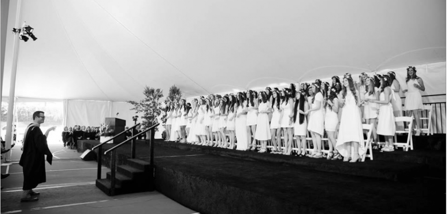 Class of 2014 at Graduation, being led by Dean Reed Farley in their graduation song. Picture was obtained from The Archer School for Girls Public Facebook Profile.