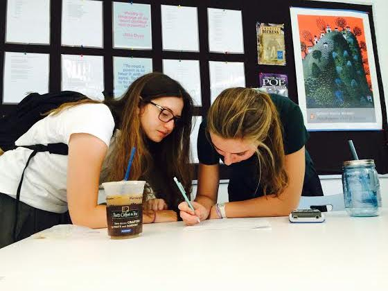 Sarah Wagner ('16), helps Haley Kerner ('16), with her pre-calculus homework.