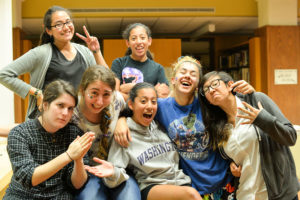 High Schoolers hang out and laugh in their pajamas before going to bed in the Archer Library.