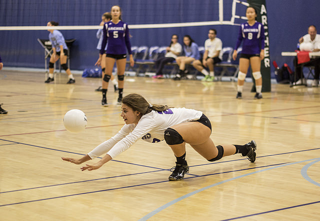 Libero Val Pianiri '17 digs the ball in a Varsity game against Holy Martyrs.