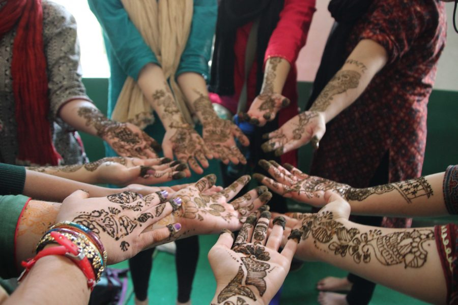 A+few+girls+show+off+their+henna%2C+which+is+a+well+known+Indian+tattoo+art+that+is+made+from+a+plant+based+dye