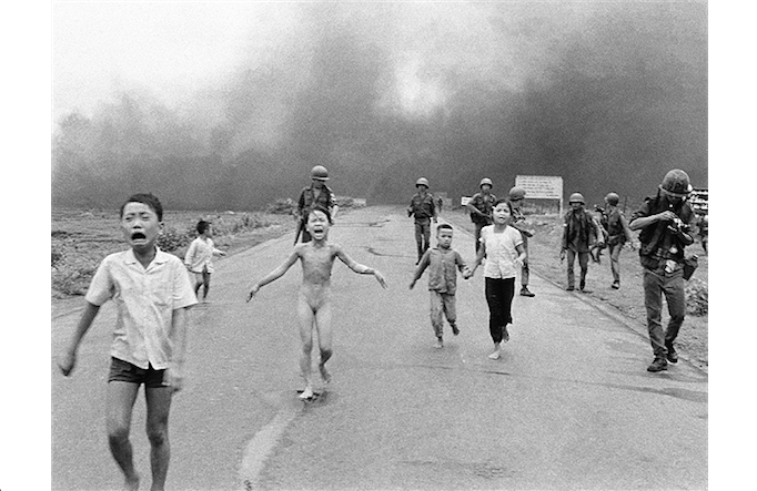 Kim+Phuc%2C+center+left%2C+running+down+a+road+near+Trang+Bang+after+the+South+Vietnamese+Air+Force+released+a+napalm+attack.+Used+with+permission+by+photographer+Nick+Ut%2C+Associated+Press