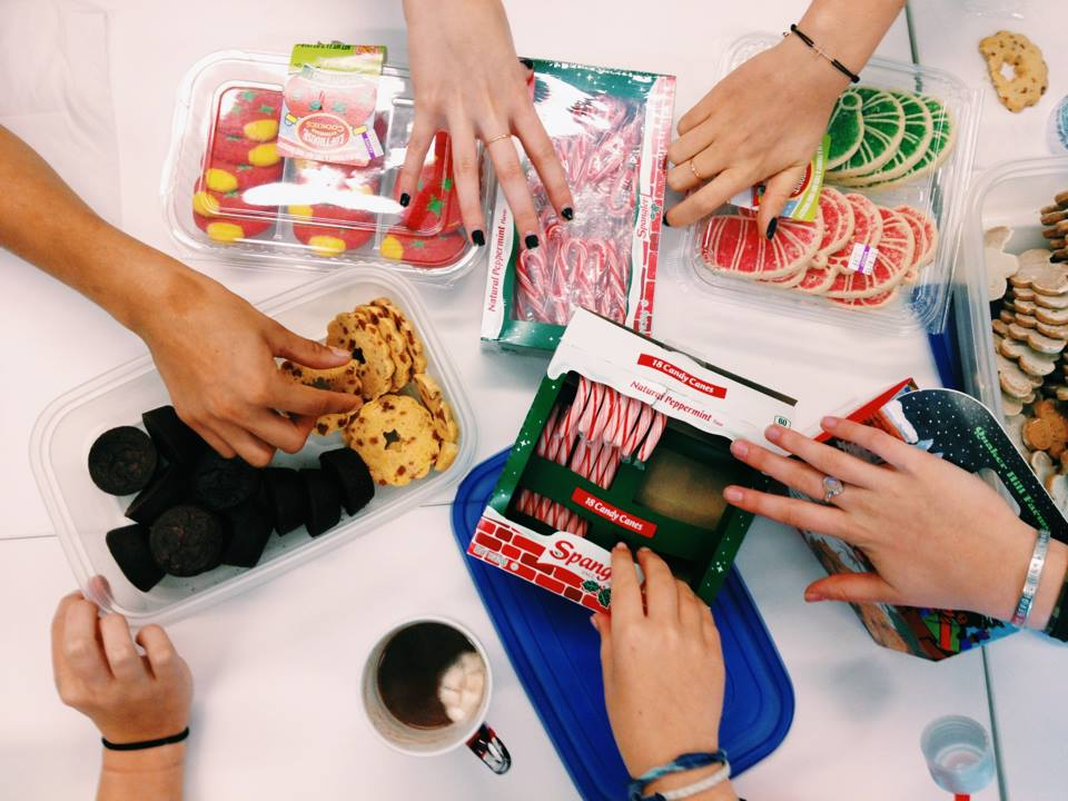 Doing what they do best, Archer girls snack on holiday goodies to relieve stress.