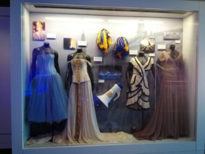 "Many memorable props and costumes from Swift's music videos are on display, including the frilly blue dress from the ""Our Song,"" the gown from the ""Love Story,"" and the pompoms from ""Shake It Off."" Photographer: Isabelle Kantz '16"