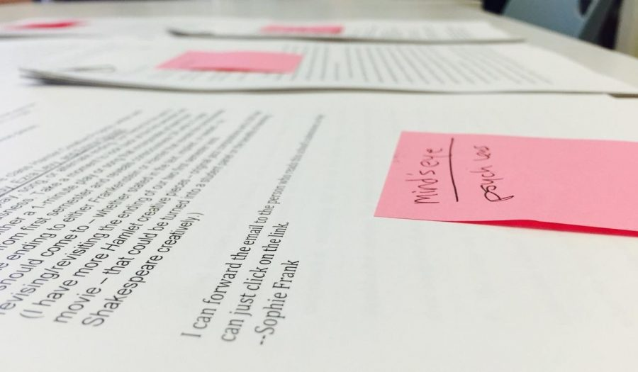 Student papers sit on a table in Kristin Taylor's classroom. The