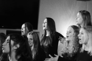 The Upper School Choir sang their hearts out with Ms. Burns at the helm. Photographer: Shishi Shomloo '15