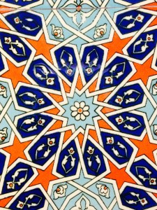 """The mosaic tiles at the King Fahad Mosque glimmer brilliantly at sundown. According to the mosque's website, the """"handmade tiles [are] from Turkey."""""""