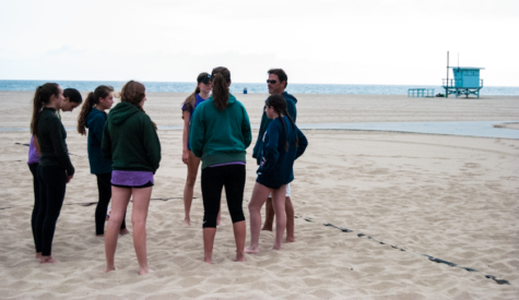 Varsity beach volleyball competes in league meet, qualifies for playoffs