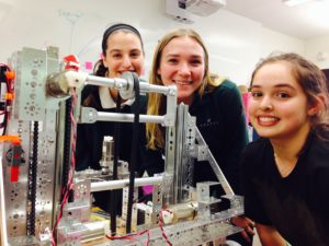Robotics Team captains Ari Brown '16, Sofia Garrick '16 and Reanna Wauer '16 pose with their semi-completed robot before a competition. The team meets in the Sabaan IDEA Lab on Wednesdays at lunch. Photographer: Syd Stone '16.