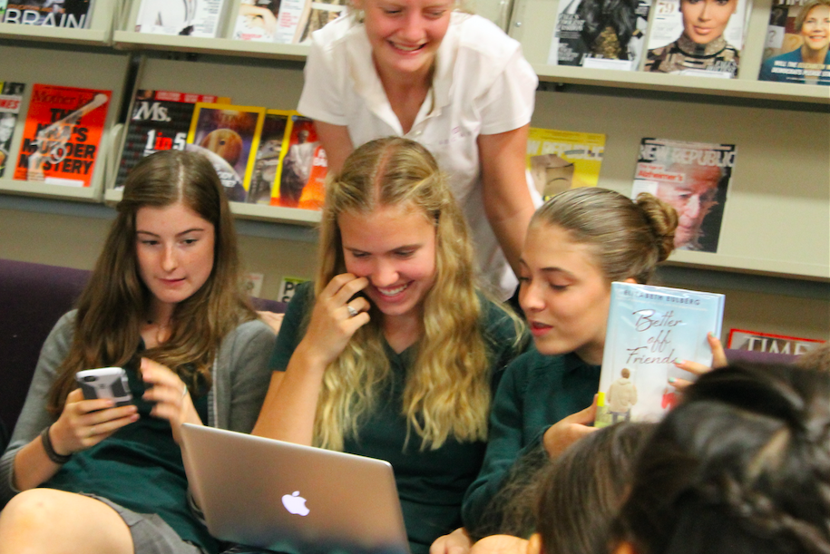 Girls meet for book club and discuss what their first book should be. Girls from almost every grade attend this club. Photographer: Chloe Davenport '19