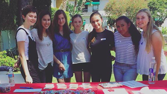 The Community Service Board poses during the Archer's annual Club Fair. During the 2013-2014 school year, Upper School students spent 6,616.25 hours completing community service, according to CSB records. Photo by Theresa Dahlin