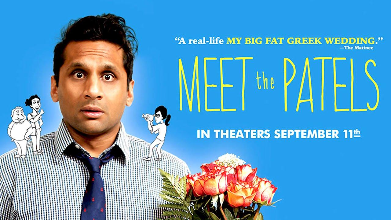 Ravi Patel holds a bouquet of flowers on the