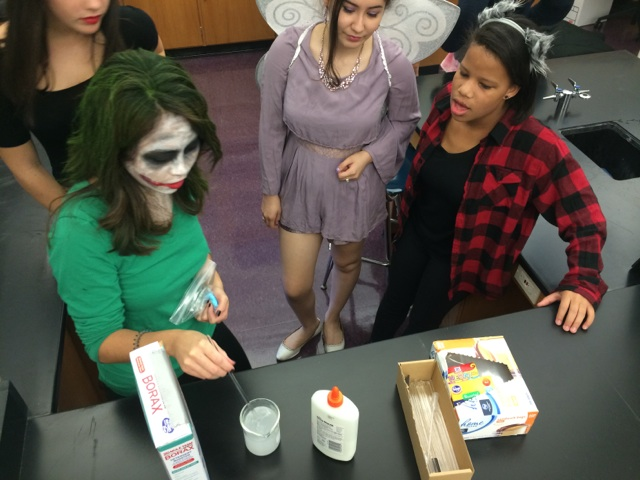 Students+in+chemistry+teacher+Kelsie+Honda%27s+class+collaborate+together.+They+used+knowledge+from+previous+lessons+to+create+slime+for+Halloween.