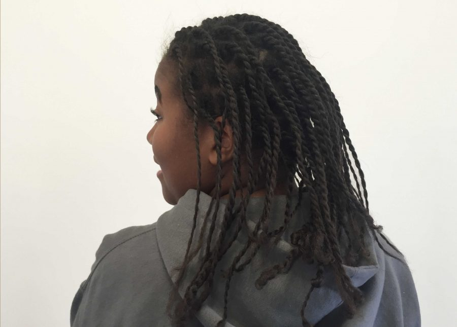 Shelby Mumford '16 showcases her braids as part of the Natural November Challenge. She, along with other members of BSU, will participate in the month-long challenge and debrief on their experience once a week. Photo by Carina Oriel '16