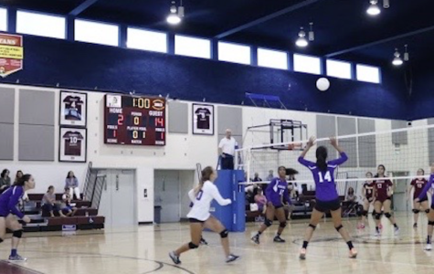 Roberts, number 14, sets in the ball in a game against Armenian General Benevolent Union Manoogian-Demirdjian School. As a sophomore, she was co-captain of the junior varsity team and moved to varsity midway through the season.