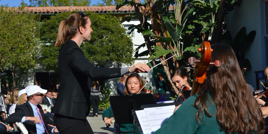 Ms. Smith conducting the Archer orchestra on Founders Day. The girls had been practicing their pieces for the day since school started. Photographer: Nelly Rouzroch'18