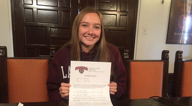 Christian Luhnow poses with her letter of intent to Lafayette College. Lafayette is a liberal arts school located in Easton, PA. Photo courtesy of Christian Luhnow '16.