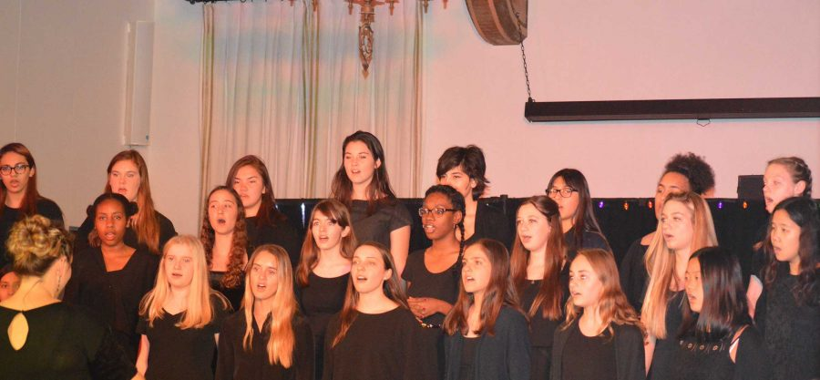 The+Upper+School+Choir+sings+during+the+2015+Winter+Concert.+Girls+of+all+grades+at+Archer+sang+in+the+concert.