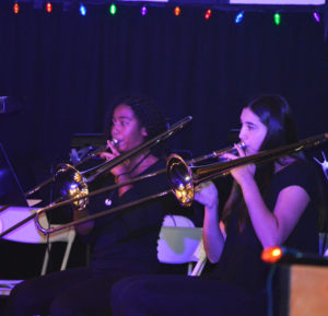 Girls playing in part of the orchestra at the winter concert. Photographer: Sage Brand-Wolf 19'.