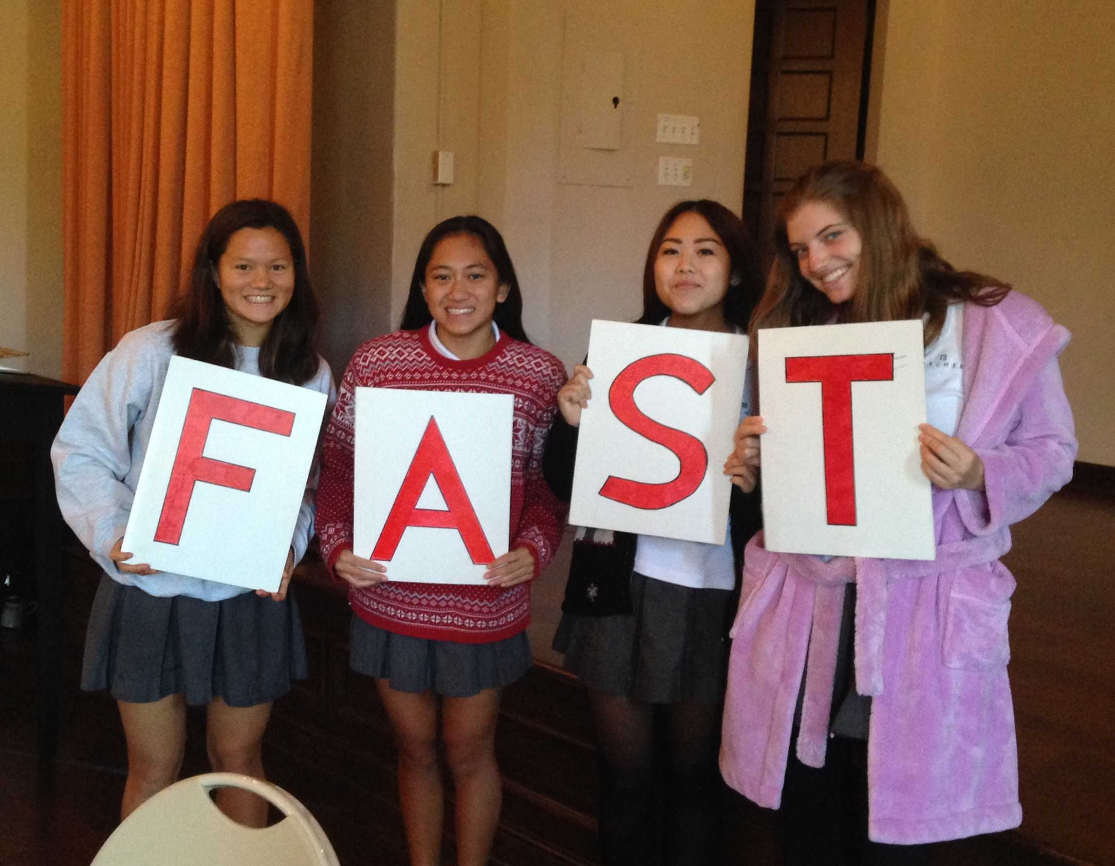 From left to right, Saskia Wong-Smith, Summer de Vera, Sydney Shintani, and Sara Friedman all '18 hold up