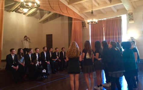 A capella groups University of St. Andrews' The Other Guys and Archer's Unaccompanied Minors gather in the Rose Room. Both groups sang for one another and participated in a jam circle.