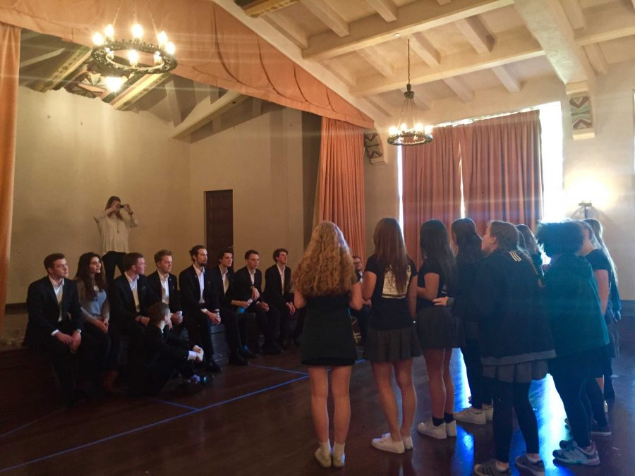 A+capella+groups+University+of+St.+Andrews%27+The+Other+Guys+and+Archer%27s+Unaccompanied+Minors+gather+in+the+Rose+Room.+Both+groups+sang+for+one+another+and+participated+in+a+jam+circle.
