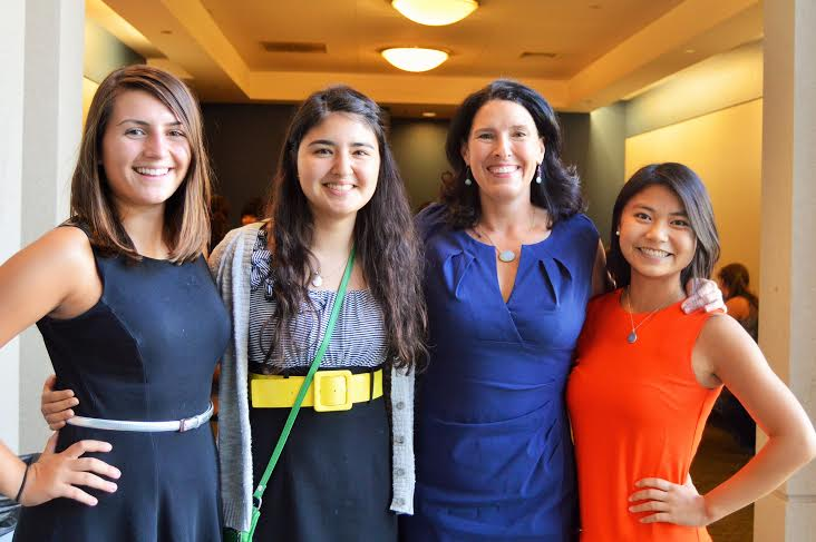 Susannah Wellford, third from the left, poses with 3 Running Start students. Image courtesy of Susannah Wellford.