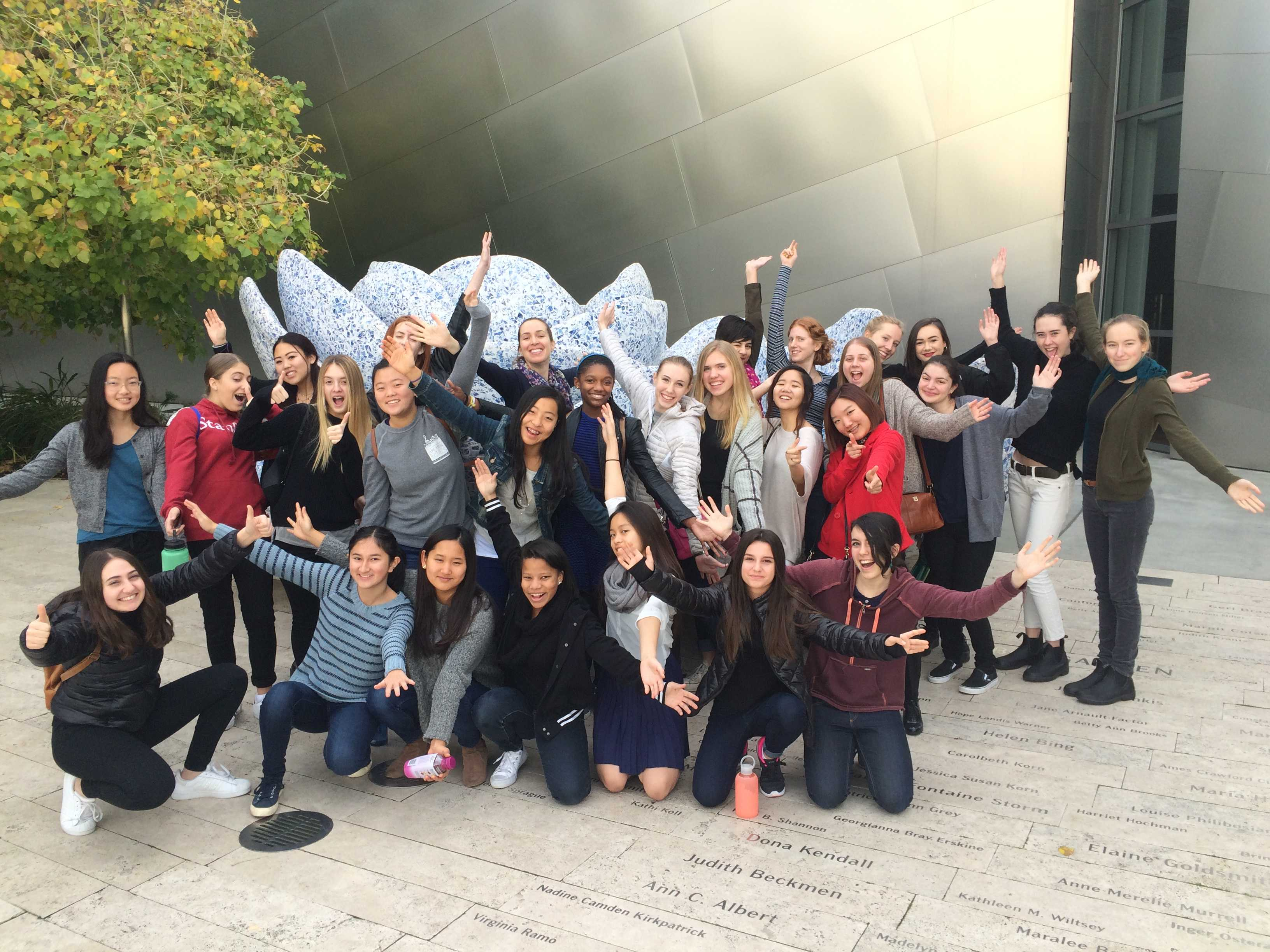 The Archer Orchestra poses together in Downtown LA during their visit to the Walt Disney Concert Hall. The group listened to and worked with the Los Angeles Philharmonic.