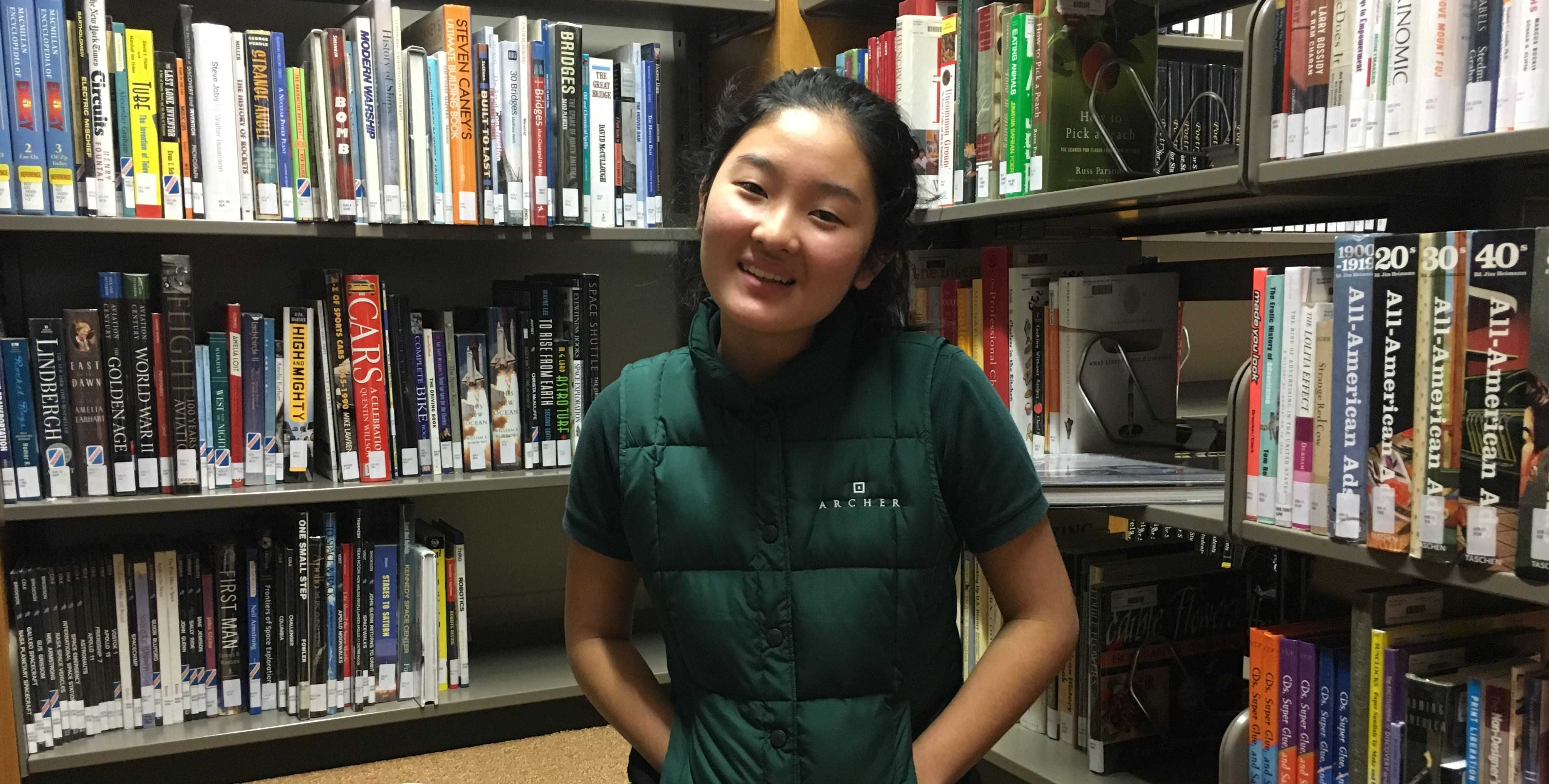 Marine Yamada '17 wears her vest in the library. She likes the vest, and finds it very fashionable. Photo by Anika Bhavnani '17