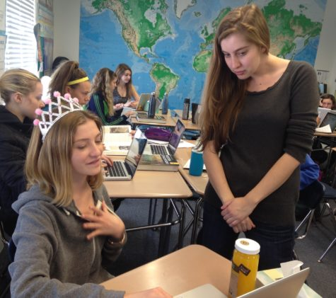 History Teacher, Johanna Greene helps Uma Halsted '18 with a research paper. Greene is in her first year teaching at Archer.
