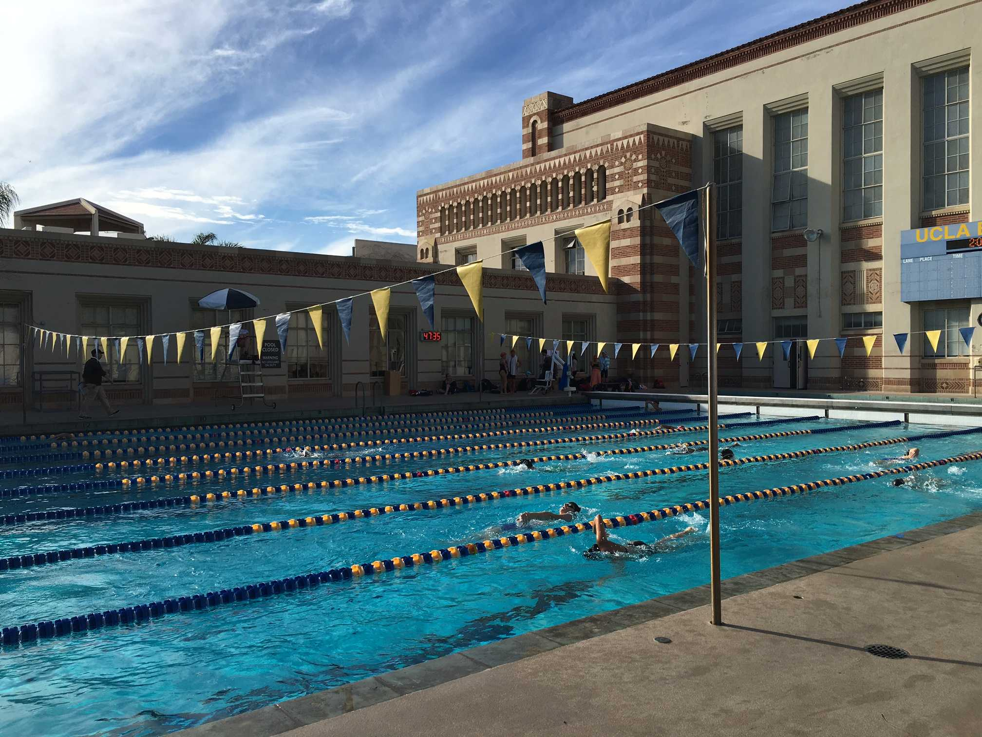 Archer's 2015-2016 upper school swim team at an invitational meet against Crossroads and Windward at UCLA. The team practices daily at UCLA.