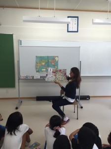 Goldberg reads a book at the Unozumai elementary school which she visits every summer. Goldberg is on Archer's community service board. Photo Courtesy of: Mari Goldberg '17.