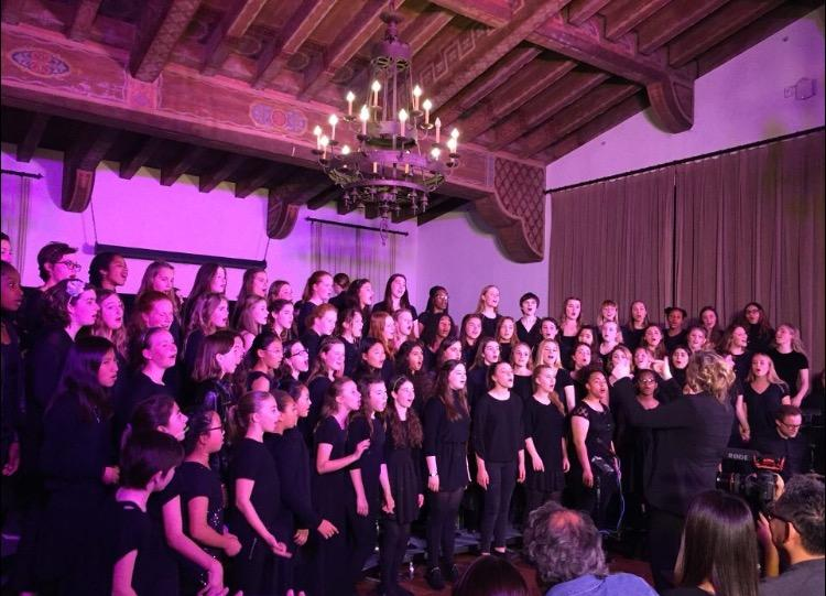 Upper+and+middle+school+choirs+and+the+wind+ensemble+sing+while+the+upper+school+orchestra+plays+during+the+finale+of+the+show.+This+year%27s+finale+song+was+%22Brand+New%22+by+Ben+Rector.+