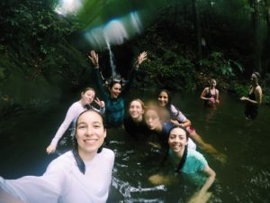 Juniors swimming under a water fall in a rainforest. Used with permission from: Avery Bush