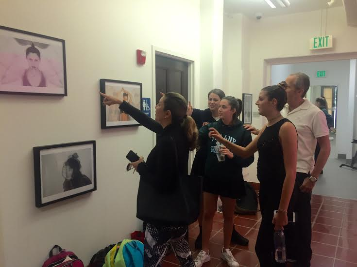 Ella Angel and Erika Kort '16 explain their artwork to attendees of their exhibit opening of Layers on Thursday, May 5.