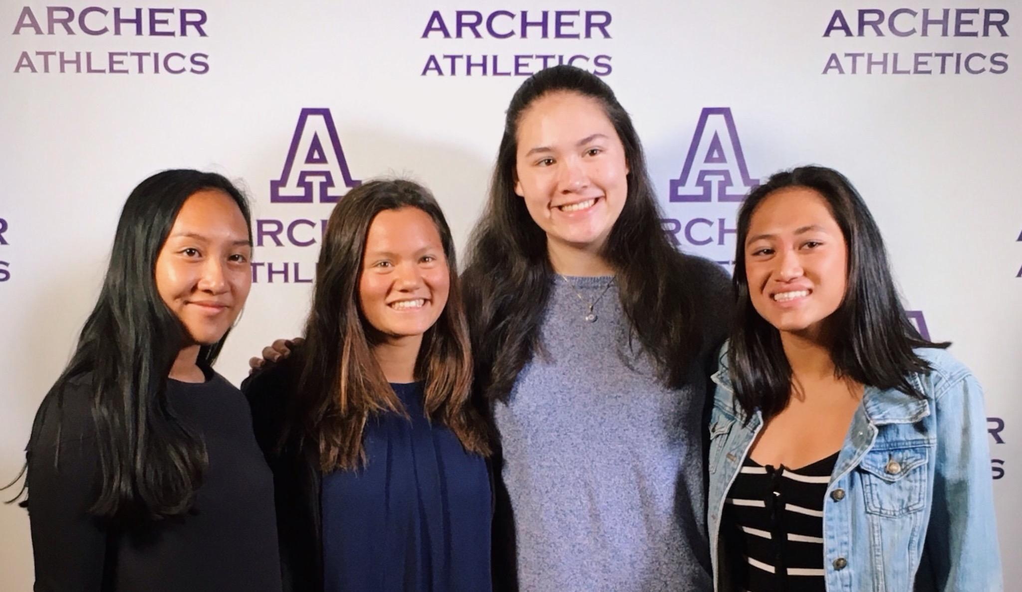 From left to right, Cat Oriel, Saskia Wong-Smith, Cybele Zhang and Summer de Vera, all '18, smile before dinner at the Olympic Collection. Wong-Smith won MVP for varsity swim.