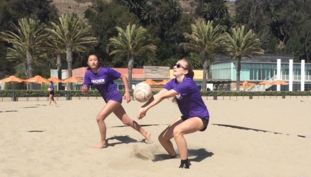 Gillian Varnum '20 digs a ball while Aloha Suto '19 runs to set it. In beach volleyball, players compete in two sets to 21 and a tie breaking third set to 15. Photo courtesy of Suto.