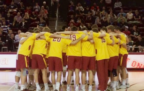 The 2014-2015 University of Southern California men's volleyball team huddles during a game against Brigham Young. The USC team included  Micah Christenson, starting USA setter.