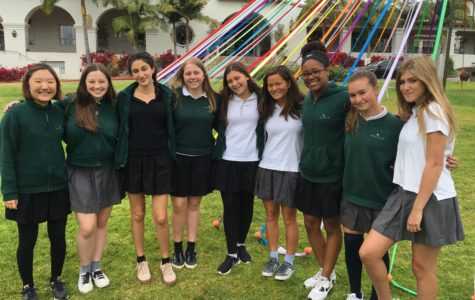 The 2015-2016 Ambassador Leadership Team (missing Ari Brown '16 and Alyssa Downer '17) pose in front of the Maypole. Their mission is to create a welcoming environment for perspective Archer families. Photographer: