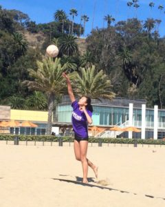Aloha Suto '19 serves the ball. A beach volleyball is softer, lighter and a little bigger than an indoor ball. Image courtesy of Suto.