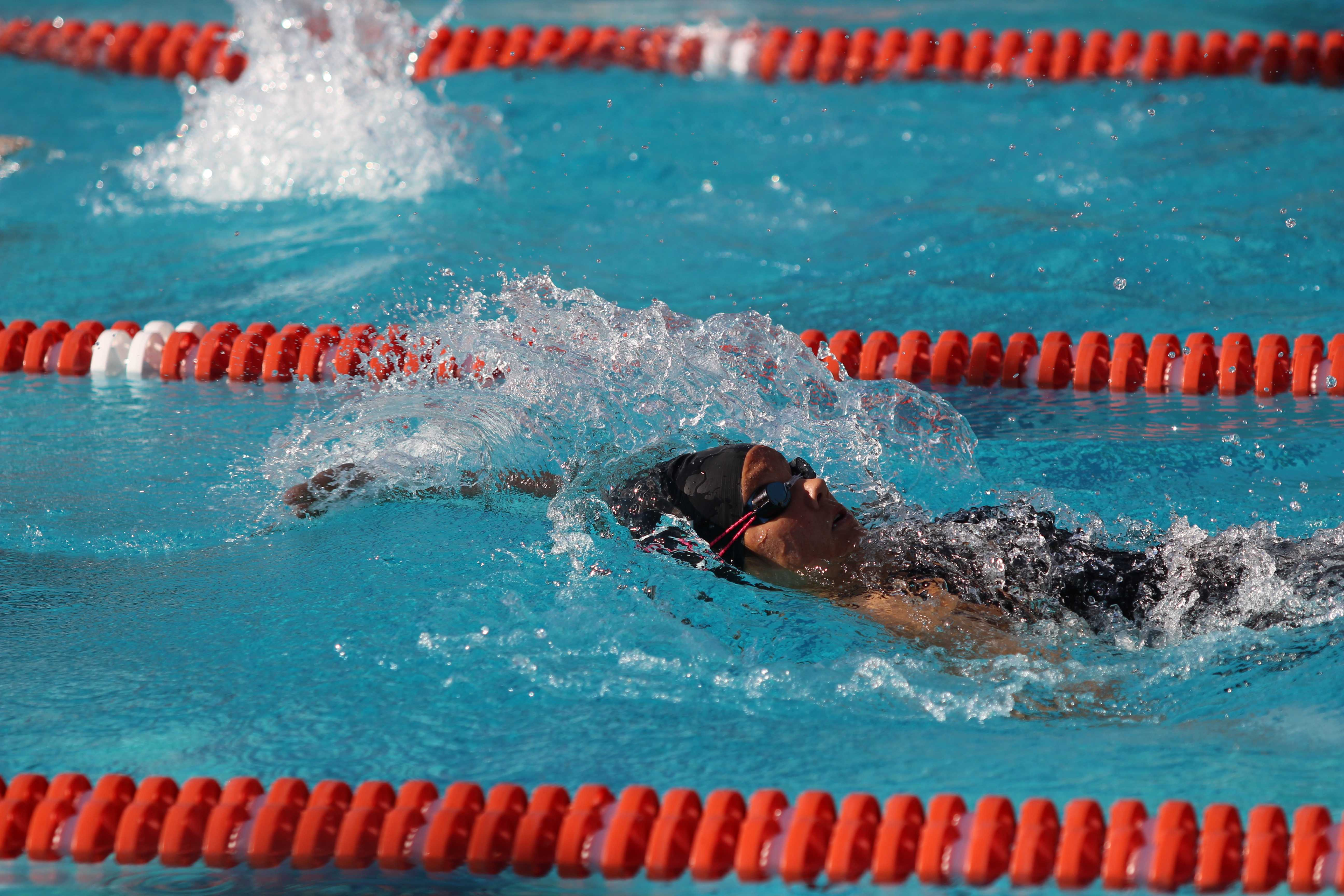 Saskia Wong-Smith '18 swims in a race. Wong-Smith set multiple league records and broke five school records. Photo courtesy of Wong-Smith '18.