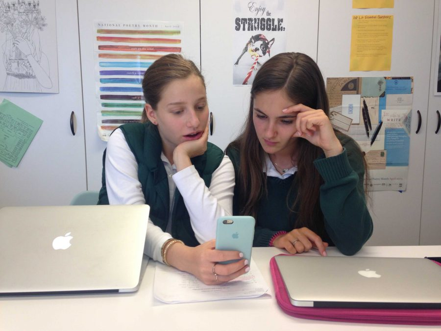 Students Ella Tollman and Chloe Davenport (both '19) are shocked to see the recent updates that the phone application, Snapchat has added. Recent additions include a baby for Mother's Day and a Taco for Cinco de Mayo.